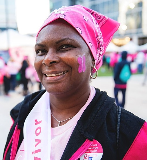 Woman wearing pink at breast cancer event