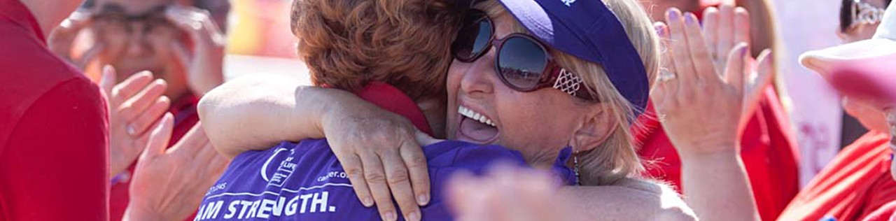 Cancer survivor hugging a fellow supporter