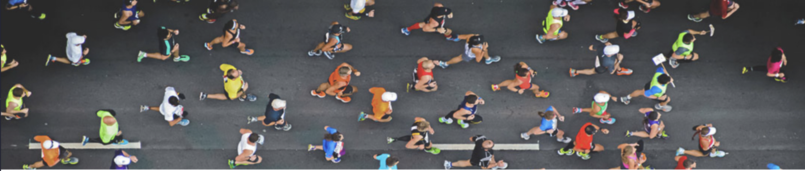 Looking down at runners on a street for a Determination marathon event