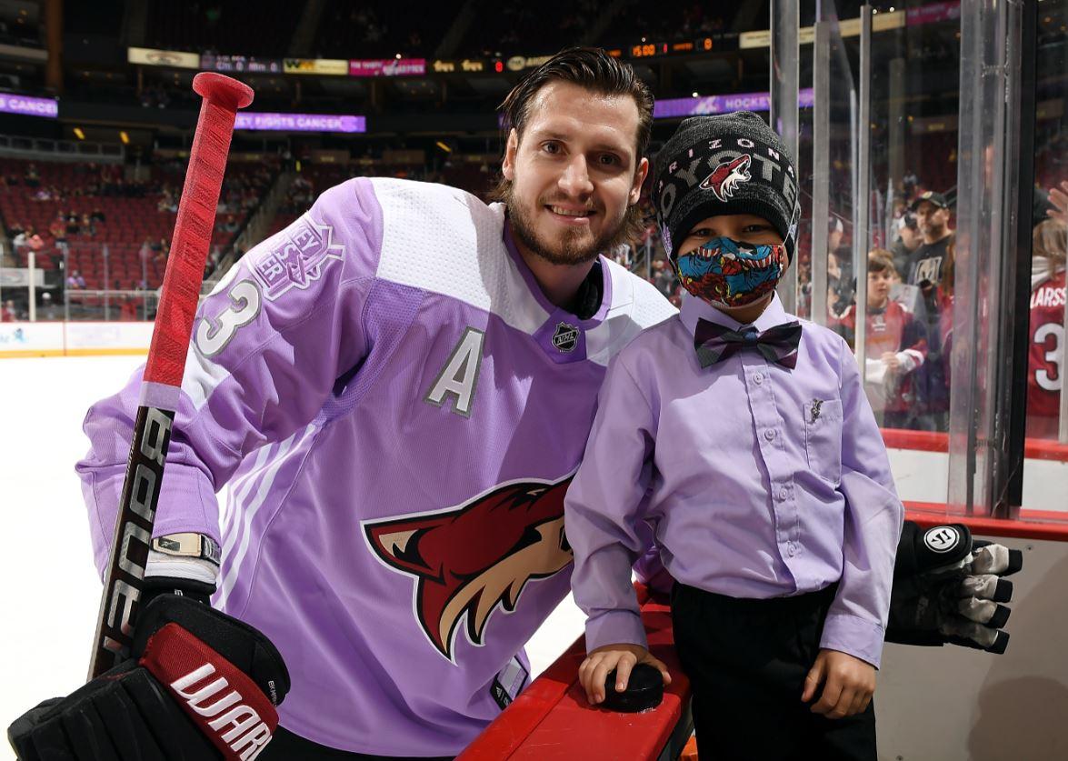 6e236e02e NHL Hockey Fights Cancer hockey player with boy.jpg