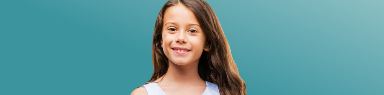 Caucasian girl with long hair smiling fin front of a teal background