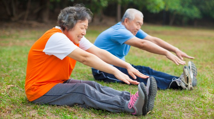 happy senior couple works out in park
