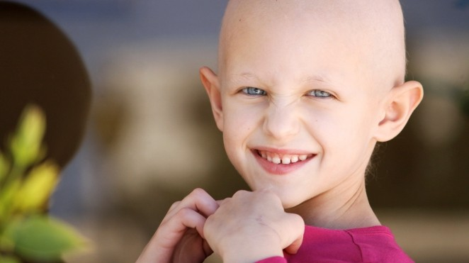 smiling childhood cancer patient