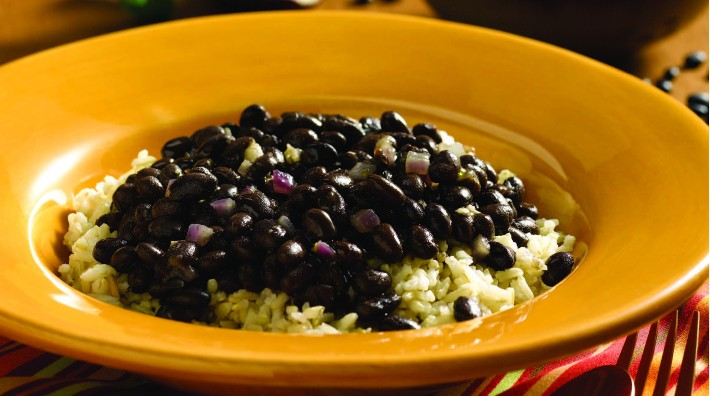yellow bowl full of Cuban-style black beans and rice