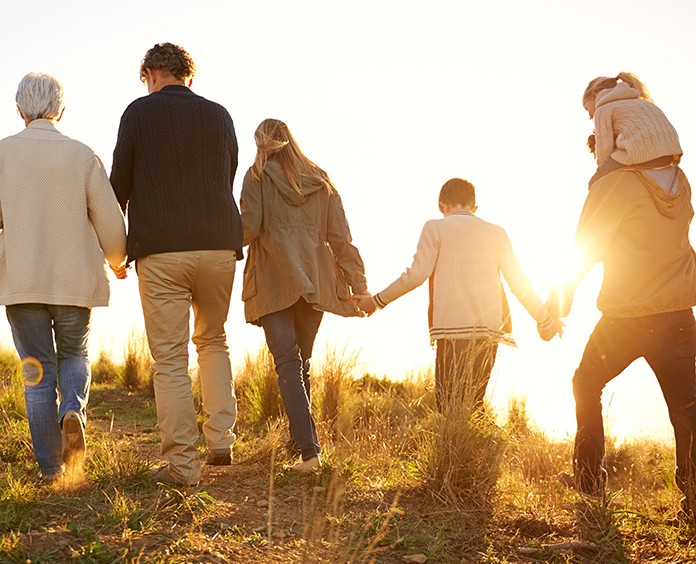 Shot of a happy family holding hands on a morning walk together