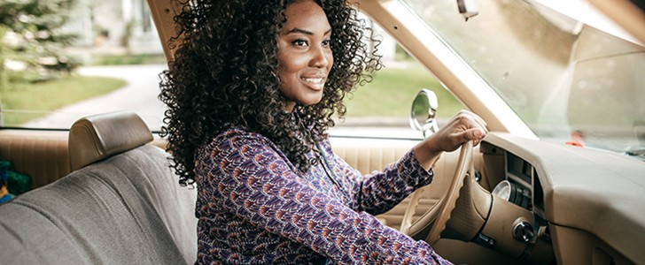 African American woman driving in a car