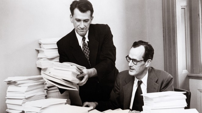 Dr. E. Cuyler Hammond (right), Director of Statistical Research, and Dr. Daniel E. Horn collect data for a 1950's landmark study on the link between smoking and lung cancer.
