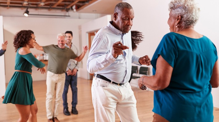 diverse group of people dancing during dance class