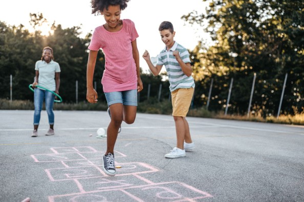 Three Kids Playing Hopscotch