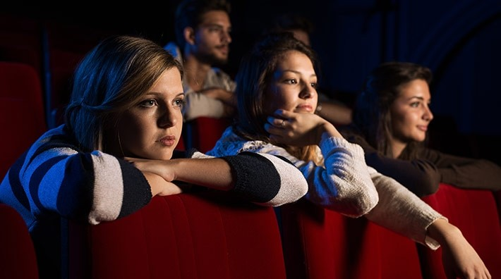 teenagers watch a movie