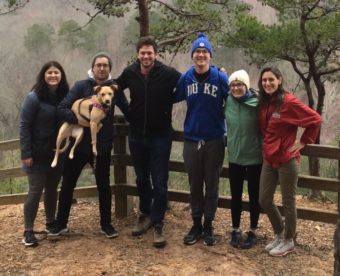 Dorothy Sipkins, MD, PhD and her lab team hiking in Hillsborough, NC.:  Sarah Ridge, PhD, Trevor Price, PhD (holding their mascot, Eleanor), Andrew Murray, PhD, Andy Whiteley, Kathleen Marsh, and Sipkins.
