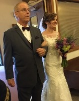 photo of Gregg Carr walking his daughter down the aisle at her wedding