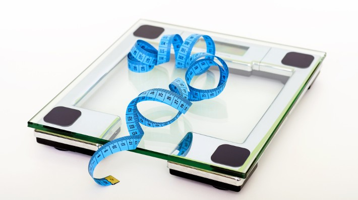blue measuring tape on top of scales