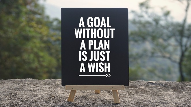 "black sign with white lettering that says, ""A goal without a plan is just a wish."""