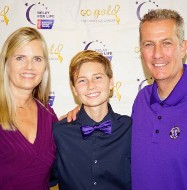 photo of Cole Eicher with his mother and father