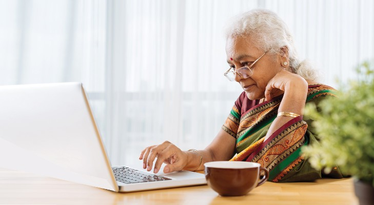 senior woman browsing on laptop computer
